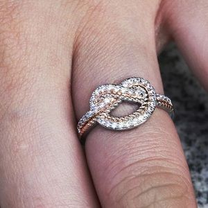 Jewelry - Two tone Micro paved heart knot ring size 6